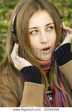 Young attractive woman with headphones