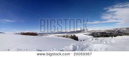 Winter Day With Snowy Hills, Blue Sky