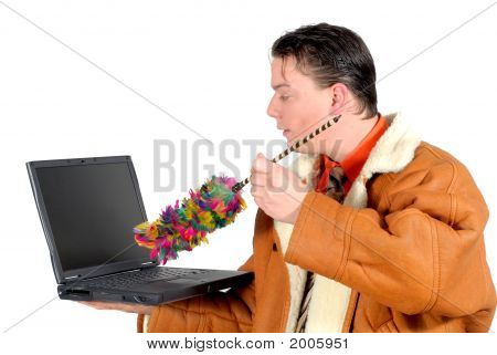 Young Businessman Cleaning Up Laptop