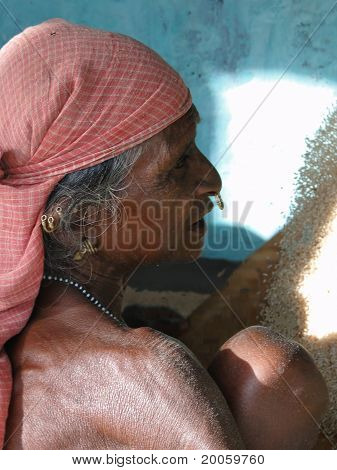 Old Woman Threshes Grain