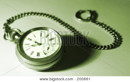 Old Silver Pocket Watches On A Chain; On A White Background