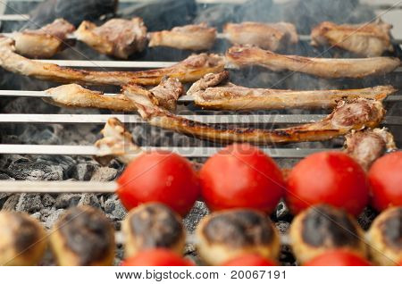 Bbq Made Of Lamb Meat, Tomatoes And Potatoes Closeup.