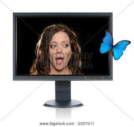 Girl  Looking At A Butterfly Fly Out Of The Monitor