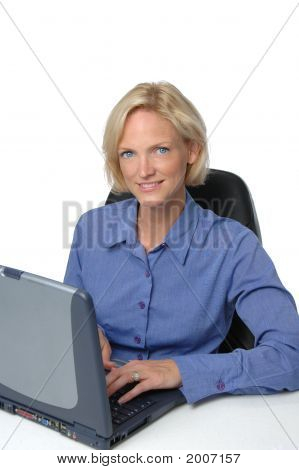 Businesswoman At Her Desk An Computer