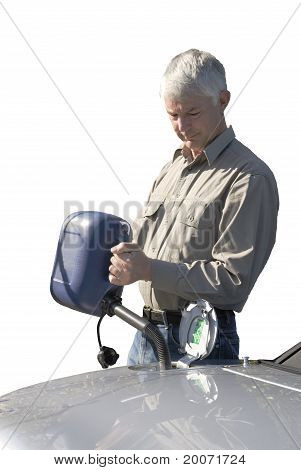 Man Putting Fuel In Car From Can
