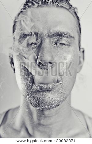 Man With A Silvery Makeu In The Smoke