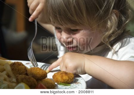 Little Girl Eating French Fries