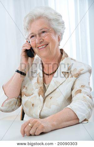 senior  woman using telephone