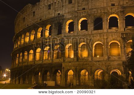 The Coloseum Glowing Golden In The Night