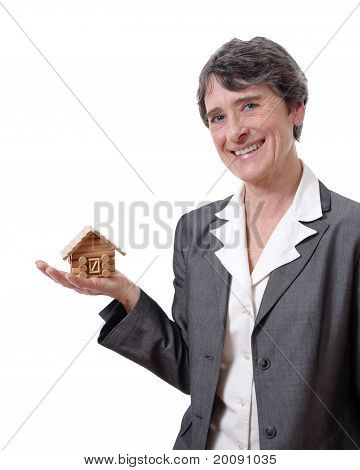 woman showing a tiny chalet