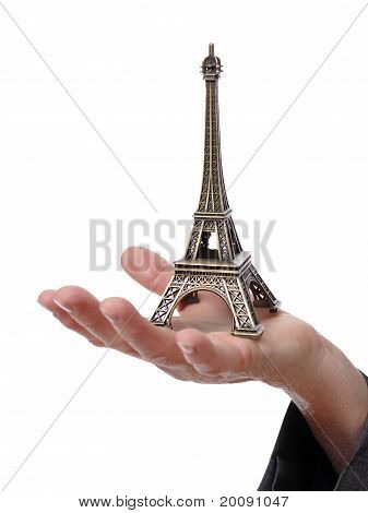 hand showing a tiny Eiffel Tower