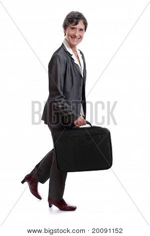 businesswoman walking with laptop