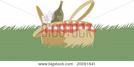 Summer wine picnic basket sitting in grass