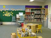 picture of book-shelf  - kids area in a library.