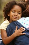 image of family fun  - Mother and child holding each other in a city park - JPG