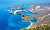 Airplane Is Flying Over Amazing Islands And Mediterranean Sea poster