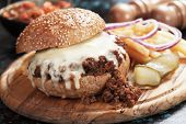 Sloppy joes ground beef burger sandwich with melted cheese poster