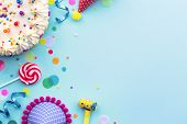 Colorful birthday party background with birthday cake and party hats poster