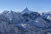 Ama Dablam Mountain Landscape. Sharp Mountain Peak Standing Out Among Himalayan Mountain Range. Stun poster