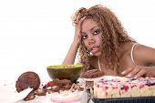 image of bulimic  - Pretty black girl looking sick with herself after having eating too much - JPG