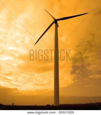Woman And Windmill In Silhouette On Irish Countryside