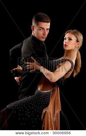 Ballroom Dancer Pair Dance Low Key on Black Background