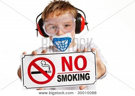 Boy with no-smoking sign.