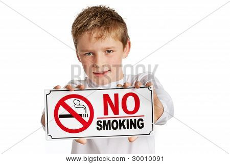 Boy holding no-smoking sign.