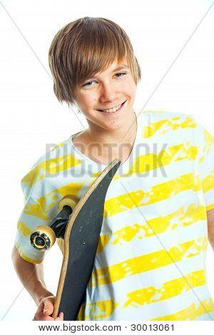 Portrait blond boy with skateboard