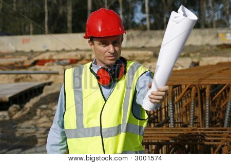 Engineer With Plans In Hand