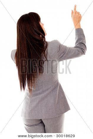 Rear view of a business woman pointing - isolated over white