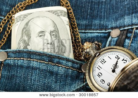 Money And Watch In A Jeans