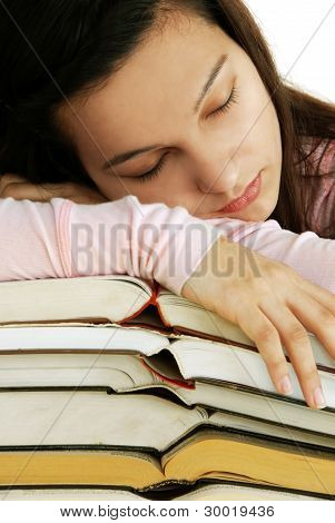 Tired Girl Sleeping On Books Stack