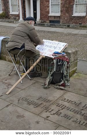 Occupy Exeter Activist Prepares A Sign Protesting Against The Anti-counterfeiting Trade Agreement (a