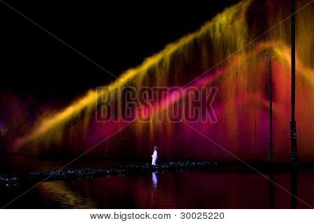 HANGZHOU, CHINA - NOVEMBER 26: An actress performs in Zhang Yimou's outdoor folk musical show 'Impressions West Lake' in an outdoor theatre built in the lake on November 26, 2011 in Hangzhou, China.