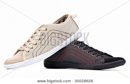 Two textile male shoes over white