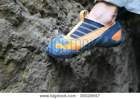 Rock climber's foot standing on foothold