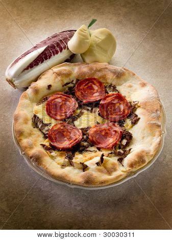pizza with hot salami and scamorza cheese