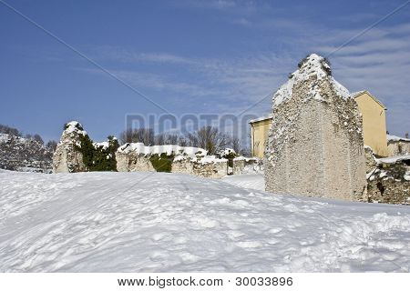 The rock ruins and the snow under the blue sky