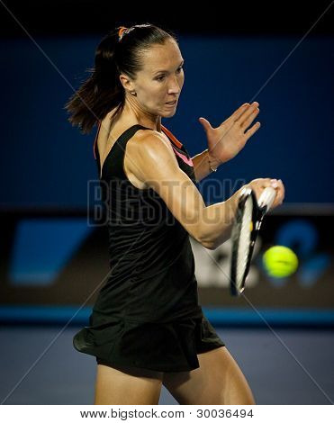 MELBOURNE - JANUARY 22: Jelena Jankovic of Serbia in her fourth round loss to Caroline Wozniacki of Denmark  at the 2012 Australian Open on January 22, 2012 in Melbourne, Australia.