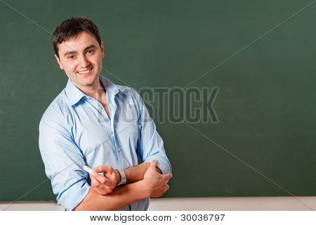 Estudiante o profesor en la pizarra