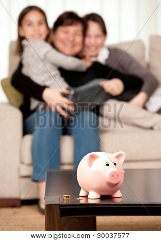 family saving money on a piggy bank