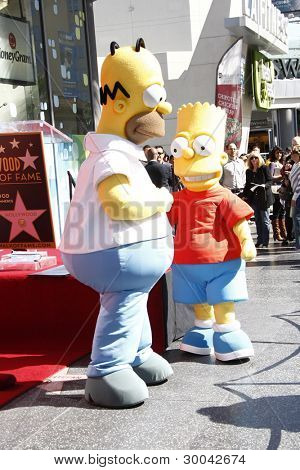 LOS ANGELES, CA - FEB 14: Bart Simpson; Homer Simpson at a ceremony as Matt Groening receives a star on the Hollywood Walk Of Fame on February 14, 2012 in Los Angeles, California