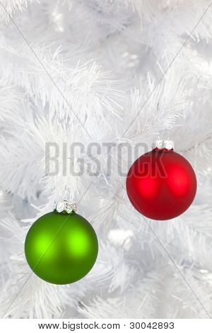 Colorful Christmas baubles, balls or ornaments on a white Christmas tree