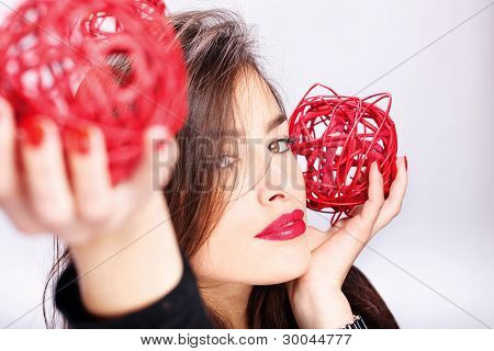 Woman Holding Two Red Balls