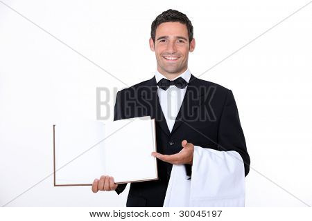 Waiter presenting menu