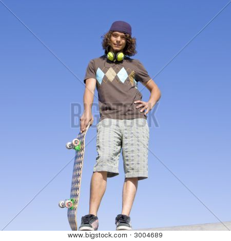 Teen Skater Atop Ramp