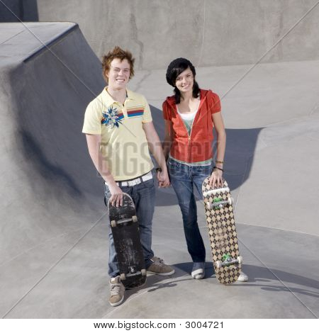 Couple At Skateboard Park