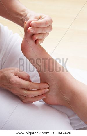 Detail foot reflexology massage