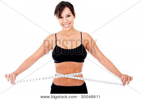 Woman loosing weight measuring her waist - isolated over a white background